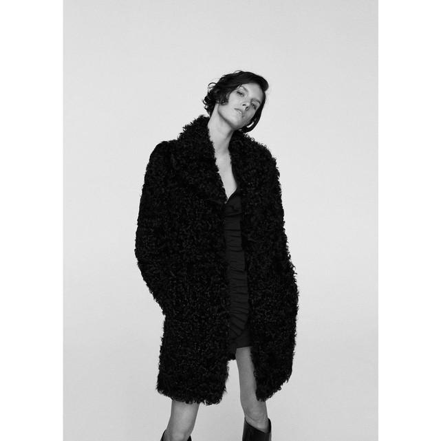 Manteau fausse fourrure revers femme